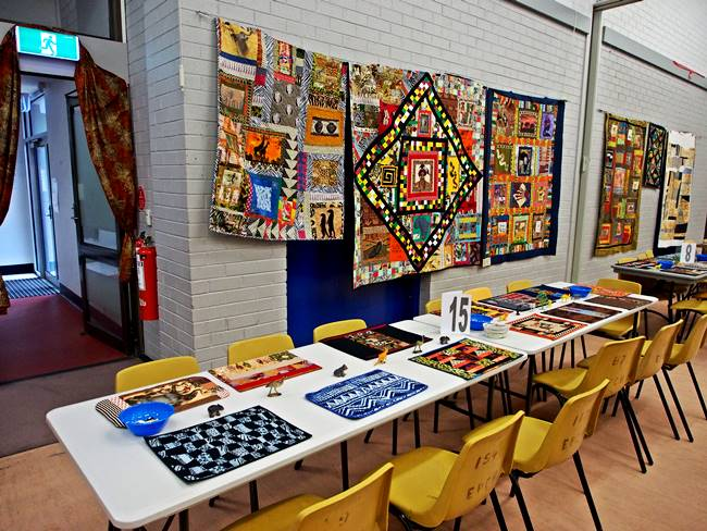 A selection of Tribal quilts as a backdrop to the tables