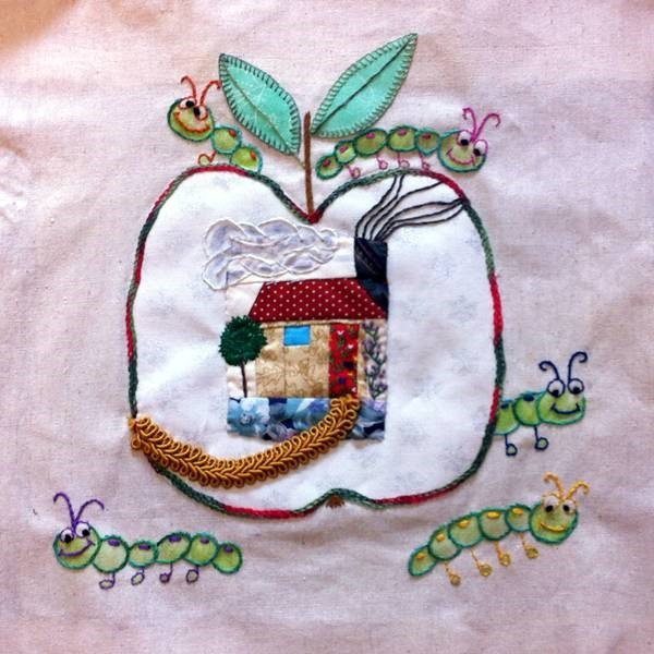 This quilt was embroidered plus some inktense pencil used on the worms